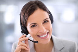 iStock-484193537-Woman-headset-smiling-1